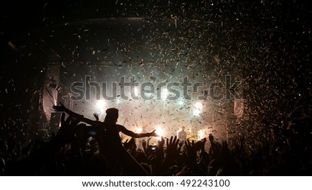 People enjoying good music - confetti falling
