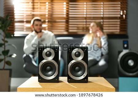 People enjoying music with modern audio speaker system in living room Сток-фото ©