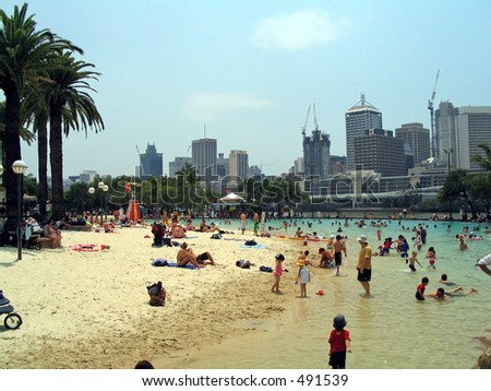 People enjoying the man made Southbank City beach, across the river from Brisbane