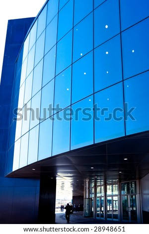 People enter to modern blue office