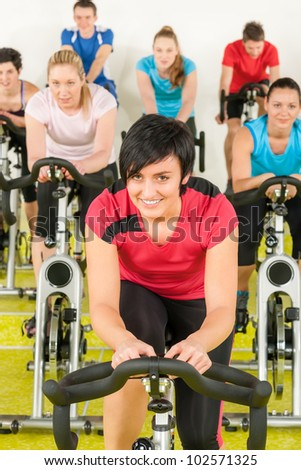 people exercise at gym enjoy workout