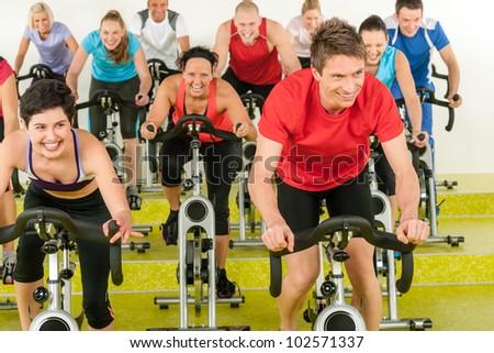 people exercise at gym enjoy workout