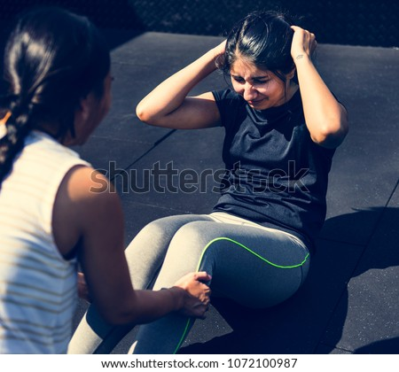 People exercising at the gym