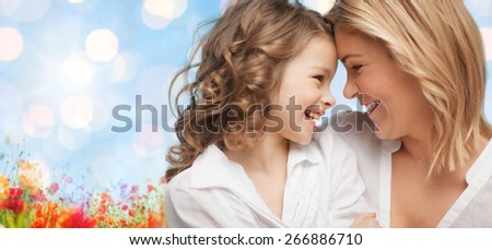 people, family, love and harmony concept - happy mother and daughter cuddling over blue sky and poppy field n background #266886710