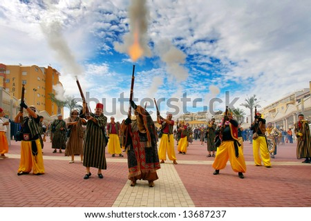 people firing/shooting with weapons during a spanish fiesta - moors and christians