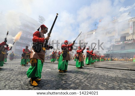 people firing/shooting with weapons during a spanish fiesta - moors and christians  - april 2008, alcoy-spain