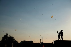 People flying kites in the roof. Ahmedabad uttarayan festival. India