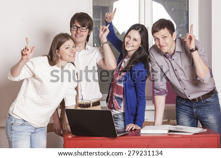 People friends working at home at the table with laptop