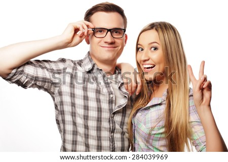 people, friendship, love and leisure concept -  Beautiful young loving couple smiling while isolated on white background