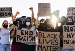People from different culture and races protest on the street for equal rights - Demonstrators wearing face masks during black lives matter fight campaign - Focus on black girl eyes