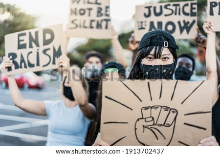 People from different culture and races protest on the street for equal rights wearing protective masks - Focus on asian girl face Stockfoto ©