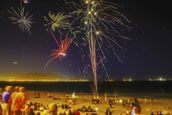 People gathering on this famous beach with Table Mountain in the background to view the colorful fireworks.