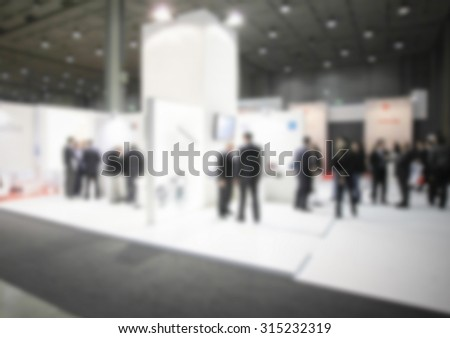 People, generic event background, intentionally blurred post production.