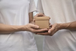 People giving giftbox concept happy new year, Valentine's day, Man giving giftbox to women