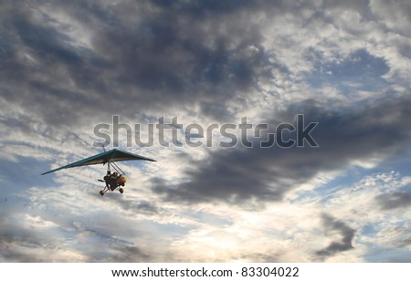 People glides in the sky with clouds, flying towards the Sun