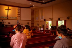 People go to church for Sunday prayers.people wearing masks, praying, and standing apart,new normal,social distancing,Coronavirus outbreak and coronaviruses influenza.