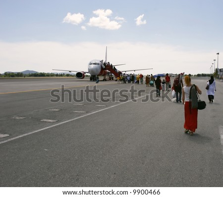 people going to small plane for departure