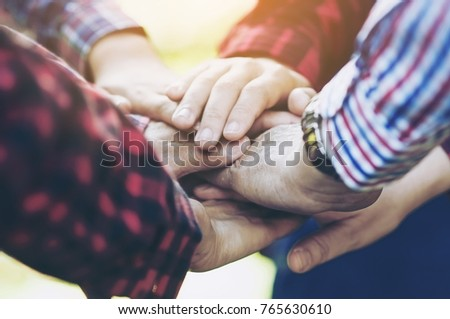 people group join hands...