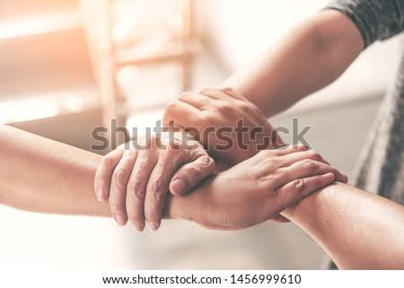 People hand assemble as a connection meeting teamwork concept. Group of people assembly hands as business or work achievement. Man and women touch each other hands after meeting. Teamwork conceptual.