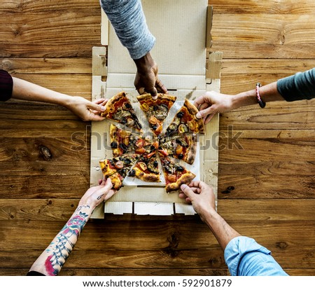 People Hands Grabbing Pizza from Delivery Box #592901879