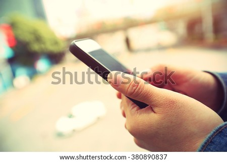 people hands use cellphone in city #380890837