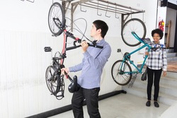 People hang bicycle on wall office diverse mix race group businesspeople casual wear