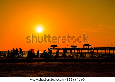 People Having a Good Time at the beach in Florida at Dusk