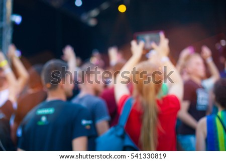 People having fun at the concert. The blur effect. #541330819