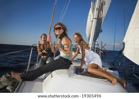 people having fun on a yacht - stock photo