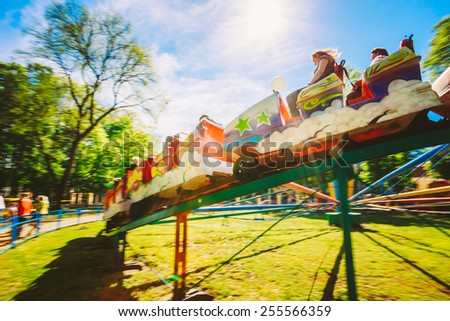 People Having Fun On Rollercoaster In The Park. Photo With Zoom Blur For Motion Effect Foto stock ©