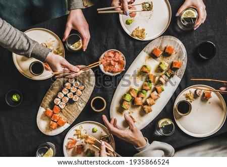 People having Japanese dinner during lockdown at home Stok fotoğraf ©