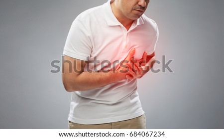people, healthcare and problem concept - close up of man suffering from heart ache over gray background