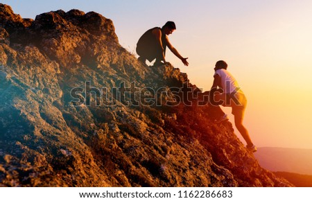 People helping each other hike on the mountain #1162286683