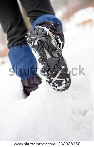 People hiking walking in white winter forest on deep snow. Recreation and healthy lifestyle outdoors in nature, motivational and healthy concept, trekking boots.