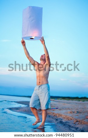 People holding a flying fire lantern