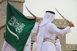 People Holding Flag of Saudi Arabia
