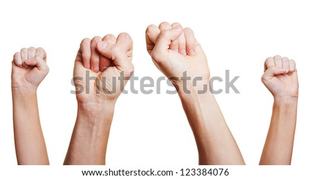 People holding four clenched fists up in the air