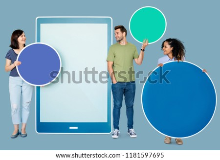 People holding geometric icons in front of a  paper cutout of a tablet #1181597695