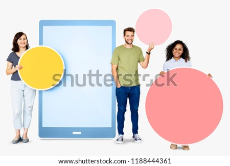 People holding geometric icons in front of a  paper cutout of a tablet #1188444361