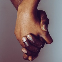 People Holding Hands Together  for Friendship. Hands of happy couple of African people which stay together.