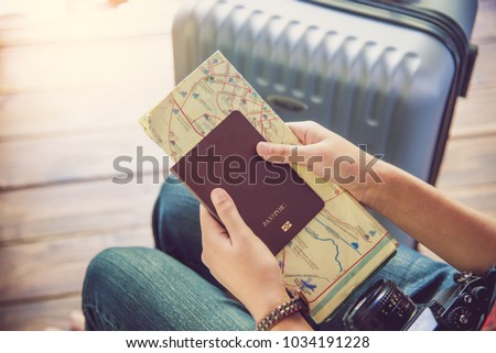 People holding passports, map for travel with luggage for the trip  #1034191228