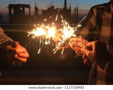 People holding sparklers #1117538981