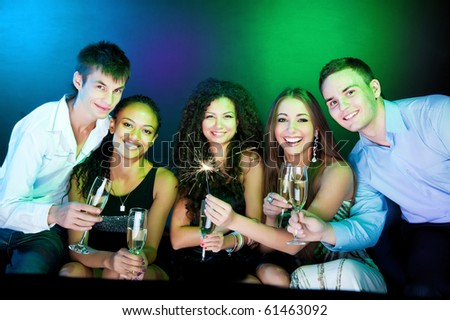 People  holding the glasses of champagne making a toast