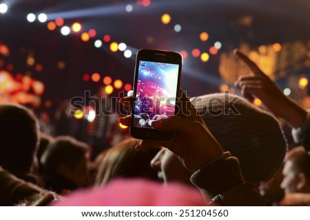 People holding their smart phones and photographing concert #251204560