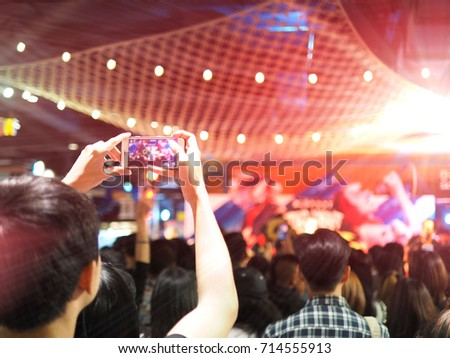 People holding their smart phones shooting video or photo concert. With copy space. #714555913