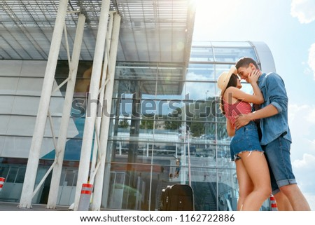 A young loving couple saying goodbye in an airport Images and Stock