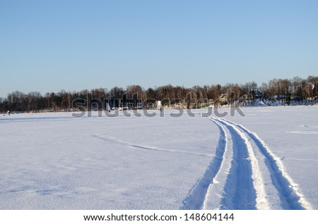 people ice sailing sport on frozen lake snow in amazing cold winter day.  modern recreation hobby.