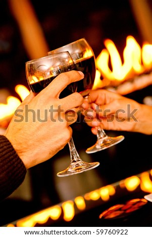 People in a romantic dinner toasting with wine