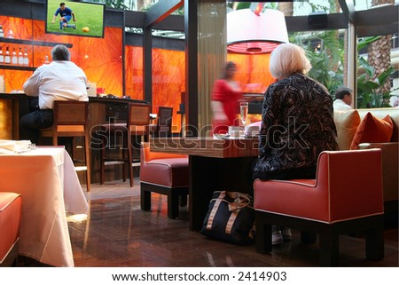 People in a sport bar. Image on tv is my own.