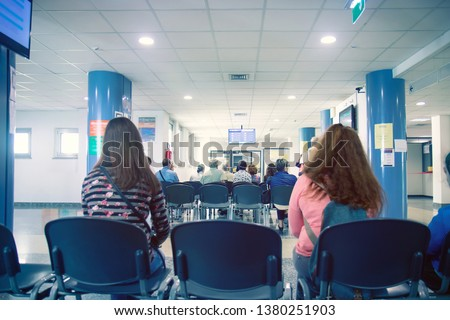 people in a waiting room of hospital, men and women wait their turn   #1380251903